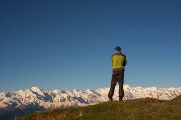 Traveler is admiring the stunning mountain range