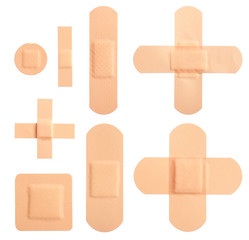 Different types of bandages on white background
