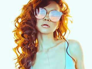 Beautiful  woman in pink-blue sunglasses