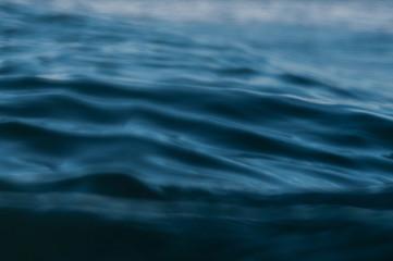 ripples in ocean water at dusk