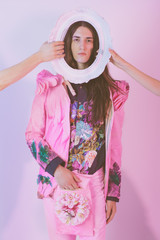 Fashion Model With Long Hair Posing in Pink Floral Costume