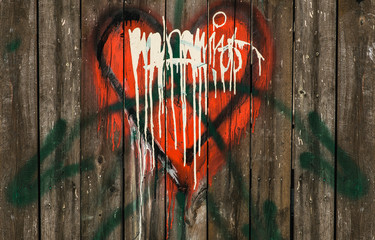 red graffiti heart on wooden wall