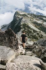 man walks on rocks
