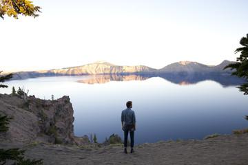 Man At The Edge Of A Lake