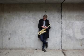 Saxophone player in urban tunnel