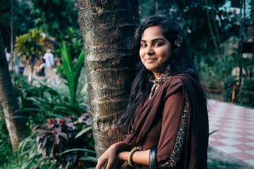 portrait of young bengali woman at park