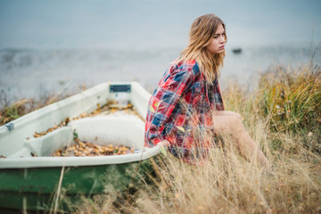 hippie girl sitting on a boat