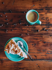 Cup of Coffee and Slice of Cake on Rustic Wood Table