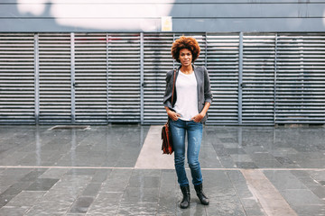 Afro american woman standing on the city street.