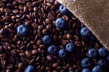 Roasted coffee beans with blueberries in a bag