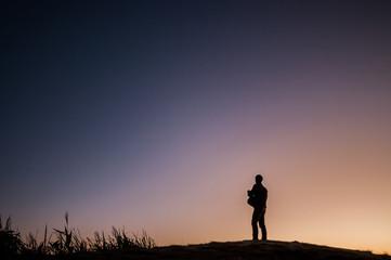 A man silhouette in twilight