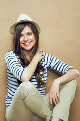 Portrait of young smiling woman wearing hat