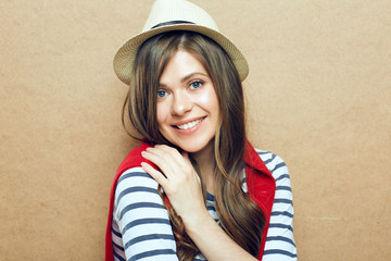 Portrait of young woman wearing hat.