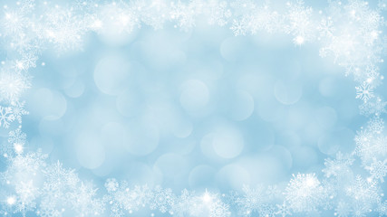 Christmas background with frame of snowflakes and bokeh effect in light blue colors