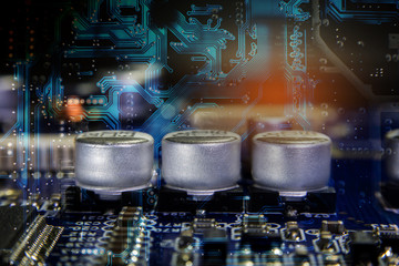 Close up macro of aluminum electrolytic capacitors installed on the motherboard and electronic component with selective focus. Electronics part concept.