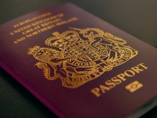 United kingdom passport on black desk, freedom of movement brexit concept