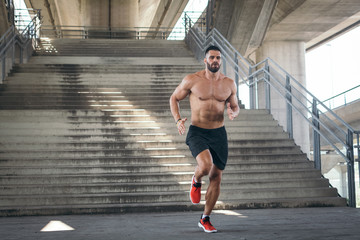 Athletic build man running
