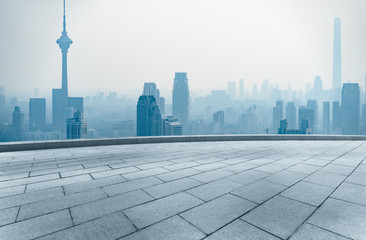 empty square front of tianjin city skyline with landmark TV tower in the fog,china.