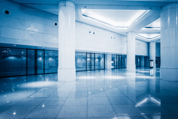 empty building hall with marbled floor,blue toned.