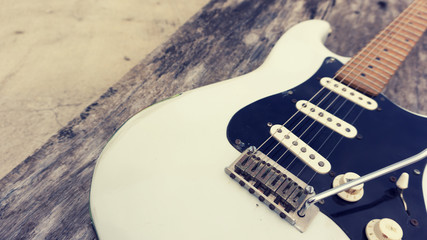A white relic electric guitar