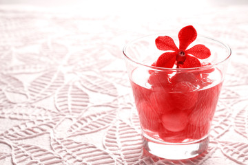 infusion water, refreshing drink of vibrant watermelon with red orchid on paper texture background, filter image