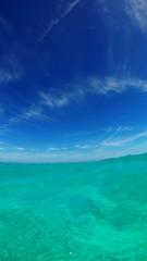 Vertical photo of the Bahamian ocean water during a beautiful day. Nassau, Bahamas.