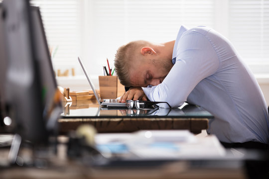 Businessman Sleeping Over The Desk