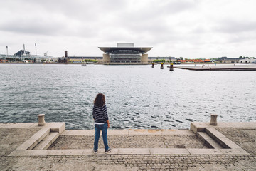 Girl looking at the waterfront