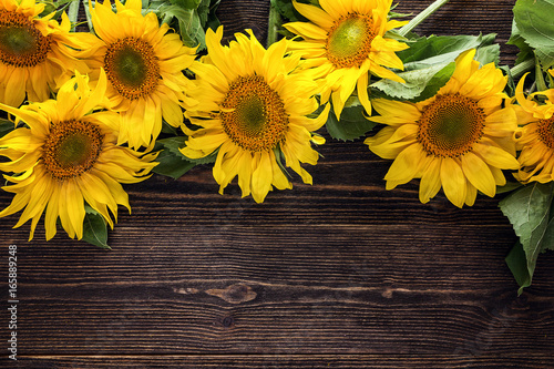 Yellow Sunflowers On A Dark Wooden Background Copy Space
