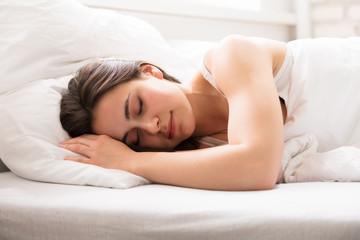 Beautiful Woman Sleeping On Bed