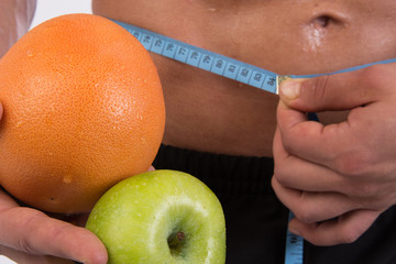 Diet and a healthy lifestyle. Fruit and attractive body.