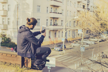 Boy taking picture with Smartphone