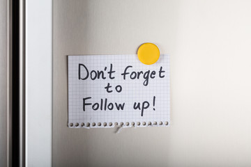 Don't Forget To Follow Up Note With Yellow Magnetic Thumbtack