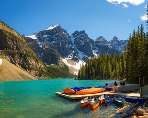 Canoes on a jetty at  Moraine lake in Banff National Park, Canada