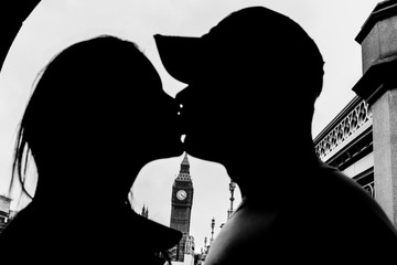 Silhouette of a romantic couple kissing near Big Ben in London