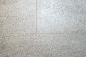 The texture of the floor ceramic tile, staggered. Background for advertising ceramics, ceramics, granite, building services