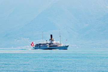Water ferry ship with Swiss flag Lake Geneva in Lausanne