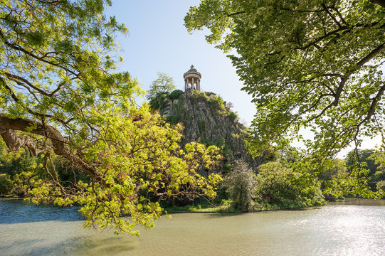 Temple de la Sibylle at the top of a rock in the middle of a lake