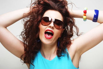 curly woman wearing sunglasses