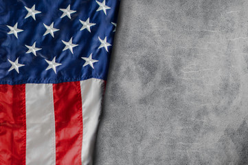American flag freely lying on Blank Cement background