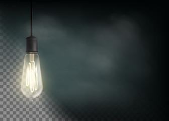 Vintage light bulb is glowing in the dark.