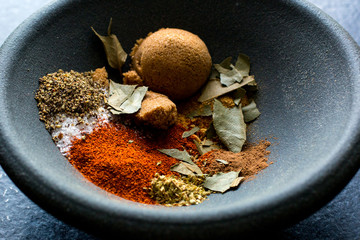 Indian spices in black bowl