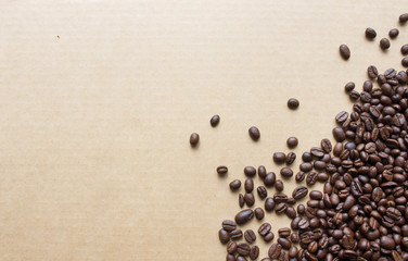 coffee bean on paper with soft-focus and over light in the background. top view
