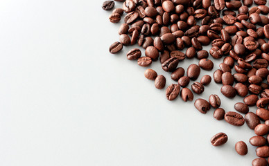 coffee bean on table with soft-focus and over light in the background. top view