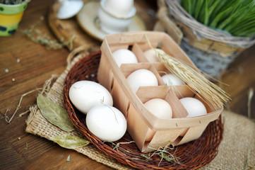 Hen eggs in basket