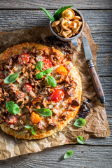 Ready to eat pizza on old wooden rustic table