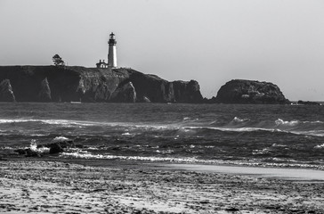 lighthouse against dramatic sky in black and white