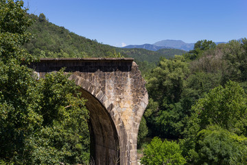 Broken old stone bridge