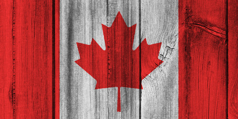 Canada flag painted on wooden wall for background
