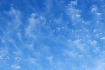 Blue beautiful sky with snow-white clouds of different shapes, background